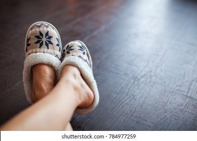 Slippers on women's legs. Soft comfortable home slipper