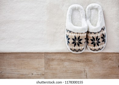 Slippers on wooden floor.Soft comfortable home slipper