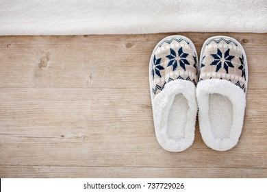 Slippers on wooden floor.Soft comfortable home slipper