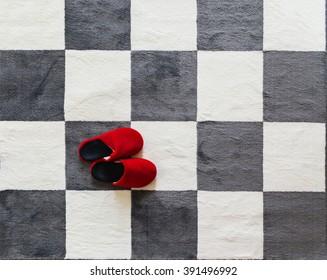 slippers red, chessboard carpet