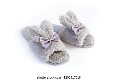Slippers in the shape of a bunny with ears isolated on a white background, women's or children's indoor clothing, cute fluffy fur slippers home