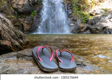 Slippers were placed near the waterfall, carefully thought out of the danger of natural tourism.