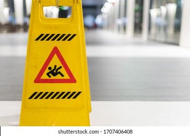 Slippery sign on wet floor in office building