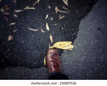 Slipping on a banana; first person perspective of a shoe stepping on a banana peel.