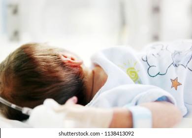 SLIVEN, BULGARIA - January 21, 2012: Newborn baby in hospital incubator.