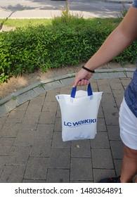 Sliven / Bulgaria - July 30, 2019 - Man holding white bag. Branded bag of LC waikiki