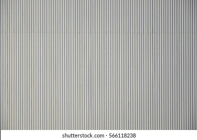 Sliver aluminium metal plate. Siding. Seamless surface of galvanize steel. Industrial building wall made of corrugated metal sheet, flat background photo texture