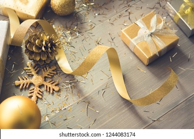 Sliver and gold shimmer Christmas gift boxes with glittering ribbon and decoration items on wood table background