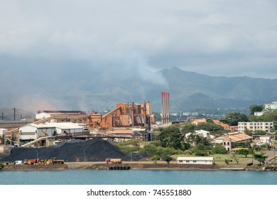 SLN Plant with smoke stack on ocean waterfront in Noumea, New Caledonia/SLN Plant/NOUMEA, NEW CALEDONIA-NOVEMBER 25,2016: SLN plant with smoke stack on ocean waterfront in Noumea, New Caledonia