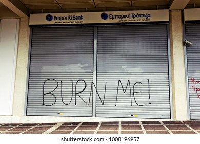 Slogan written on the closed metal shutters of a bank in Athens city center, Greece, September 12 2010.