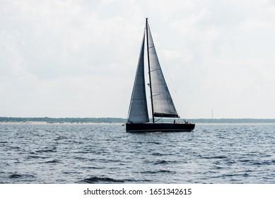 Sloop rigged yacht sailing on a clear day. Riga bay, Baltic sea, Latvia