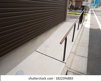 Slope installed at the entrance of the condominium - Shutterstock ID 1822396883