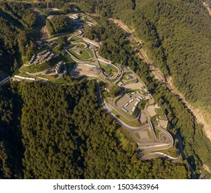 slope of a mountain covered with forest, hotels and the Olympic Luge and Biathlon (2014) complex in the city of Sochi in southern Russia