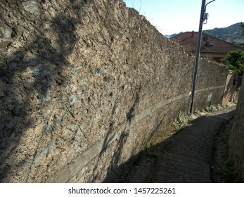 A slope with a stone wall aside.