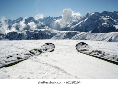 Slope view.Skis and mountain panorama.Alps