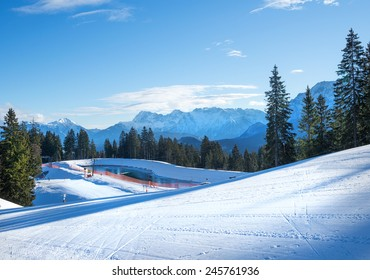 The slopes for mountain skiing at Hausberg top near Garmisch-Partenkirchen town in Bavarian Alps in Germany on a clear winter day