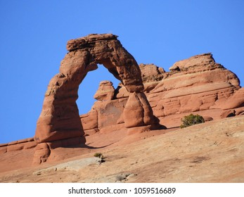 the sloping delicate arch in arches national park, near moab, utah