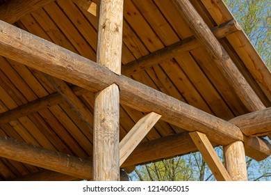 sloping roof rustic building round beam on a blue sky background natural material