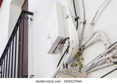 Sloppy ailing cable laying on a house facade
