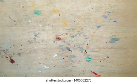 Sloppy boards with a variety of colors. Sloppy wooden board background.