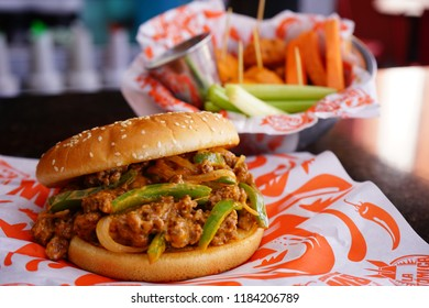 Sloppy burger with buffalo wings bowl.
