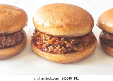 Sloppy joe - American sandwich on the white plate close up
