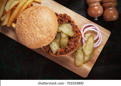 Sloppy joes, ground beef burger sandwich with pickles and french fries
