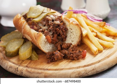 Sloppy Joe's ground beef sandwich wit pickles and french fries