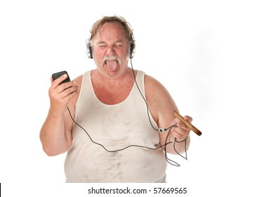 Sloppy looking man with cigar and mp3 player