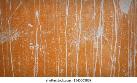 Sloppy orange stains on the walls. Sloppy orange background.