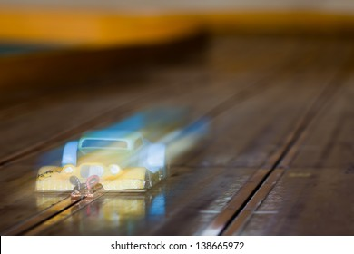 Slot Cars. A close up of small RC car racing on a track. Shallow depth of field and motion blur