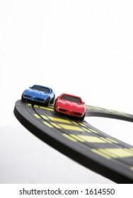 Slot cars racing on curve.