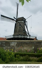 Sloten, The Netherlands - june 23 2017: The Corn mill on the wall of the former Fortified city Sloten is called De Kaai