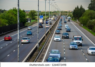 Slough, UK - May 4 2018: Traffic on the M4 Motorway looking westbound at Junction 7 at Slough.