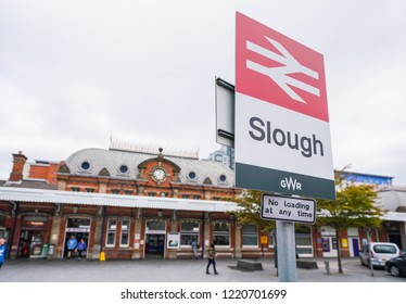 Slough/ UK - September 2018: Slough translation with a railway transport sign in front of it.