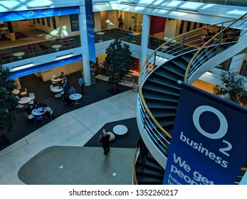 Slough, United Kingdom - 26 March 2019: Modern design architecture of interior at O2 Telefonica Slough Head Office with spiral stairs.