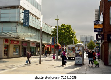 SLOUGH, UNITED KINGDOM - SEPTEMBER 7, 2017. View of High Street in Slough, with historic buildings, commercial properties.