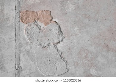Sloughed cement wall with defects. Old gray texture