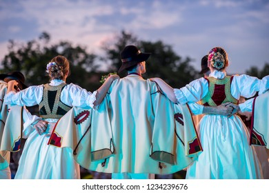 Slovak Traditional flower dancers. Folkloric beautiful costumes on stage
