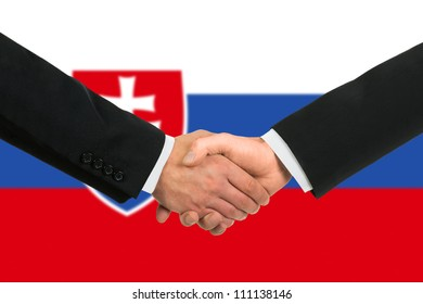 The Slovakia flag and business handshake