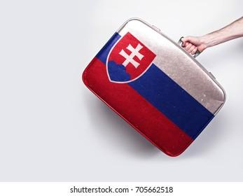 Slovakia flag on a vintage leather suitcase.