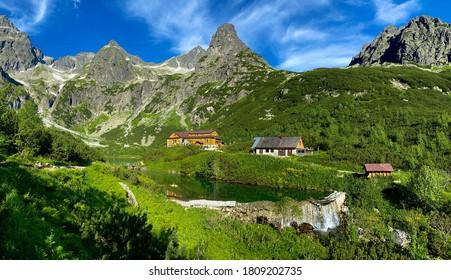 Slovakia landscape. Hut near the Zelene pleso, Vysoke Tatry NP, Europe. Sunny say in the mountains. Rocky hill isn summer season. High Tatras, lake with green forest. Travel in Slovakia.