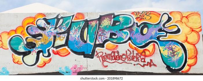 SLOVAKIA, RUZOMBEROK - JUNE 28 2014: Colorful graffiti on a legal wall in public skatepark