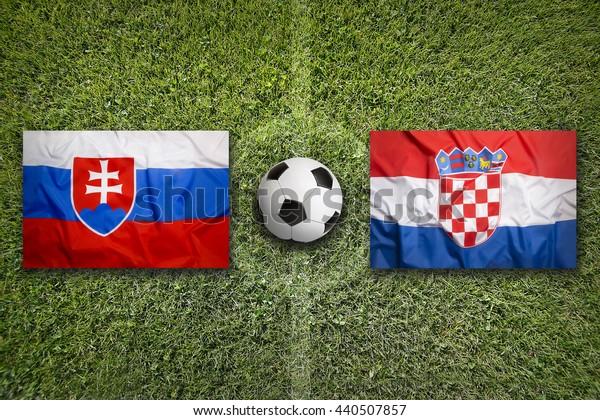 Slovakia vs. Croatia flags on green soccer field