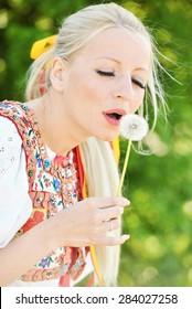 Slovakian folklore woman with dandelion