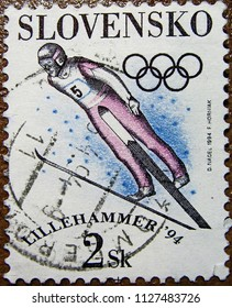 """Slovenia - CIRCA 1994: Postage stamp printed in Slovenia with a picture of a ski jumper, with the inscription """"Lillehammer, 1994"""" from the series """"XVII Winter Olympic Games""""."""