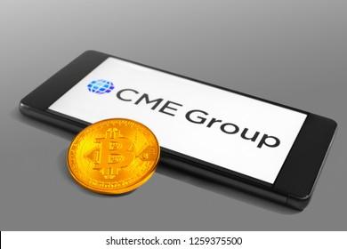SLOVENIA - DECEMBER 16, 2018: CME Group logo on a mobile device with Bitcoin coin