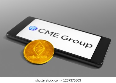 SLOVENIA - DECEMBER 16, 2018: CME Group logo on a mobile device with Ethereum coin
