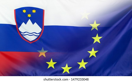 Slovenia and European Union relations concept with diagonally merged real fabric flags