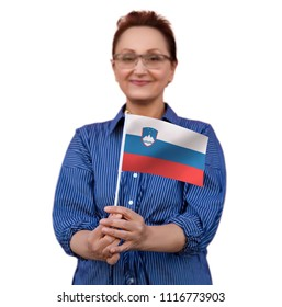 Slovenia flag. Woman holding Slovenian flag. Selective focus.Learn Slovenian language. Visit Slovenia concept.